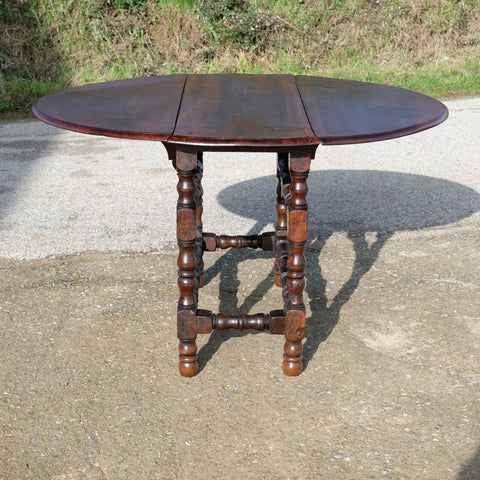 Antique oval drop leaf dining table, walnut