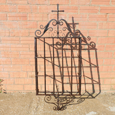 Antique wrought iron convent window grill crowned with cross