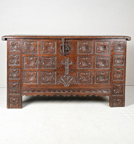 Heavily carved antique Basque arms chest, chestnut and oak