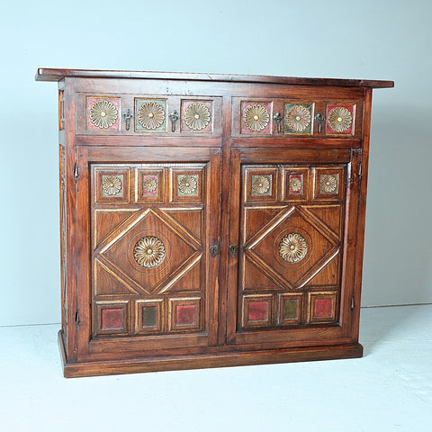 Antique carved and painted two-door, two-drawer credenza