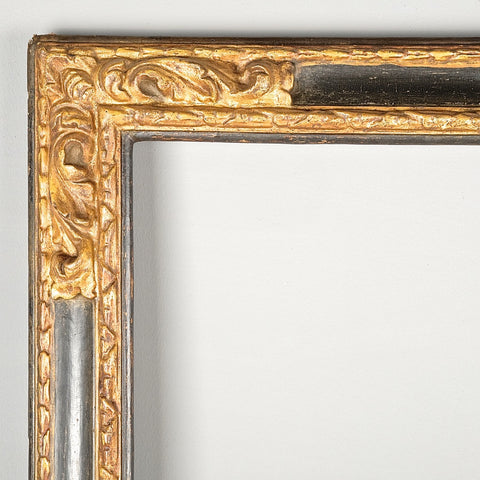 Antique carved, painted and gilt mirror frame