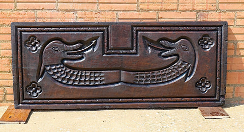 Antique chestnut panel with carved sea dragons
