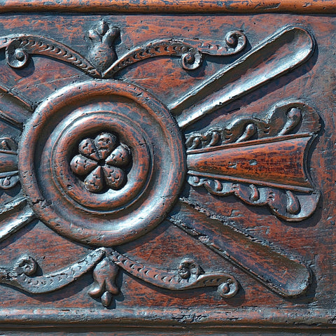 Antique chestnut panel with carved floral motifs