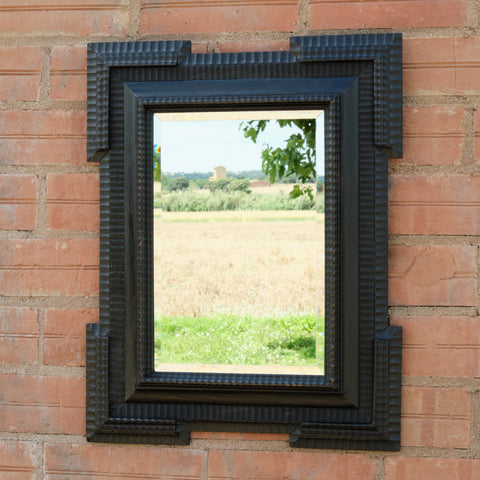 Antique black Renaissance-style mirror