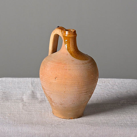 "Small semi-glazed antique clay oil jar (""Perulera"") on iron stand"
