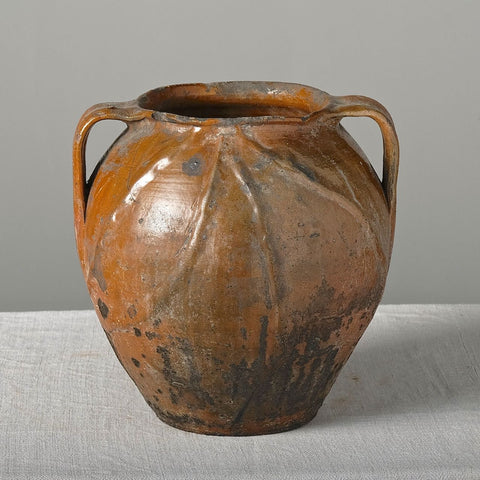 Antique two handle semi-glazed pot with braided decoration
