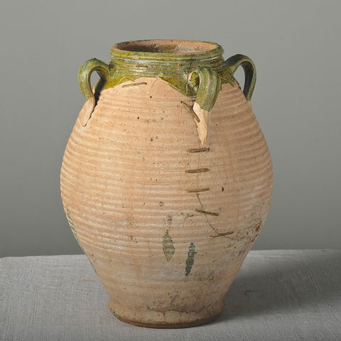 Antique ribbed semi-glazed oil jar