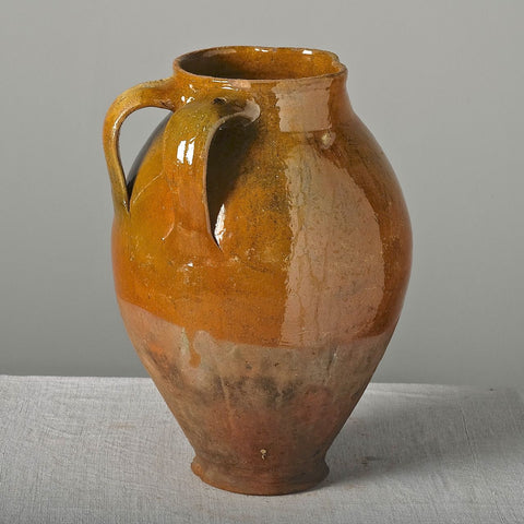 Antique large two-handle rust semi-glazed pitcher