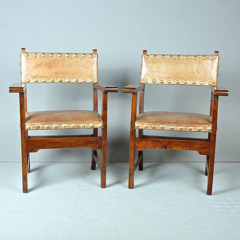 Antique carved pine village armchair with rush seat
