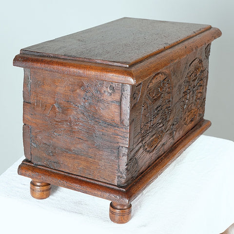 Carved antique tabletop chest, oak & chestnut