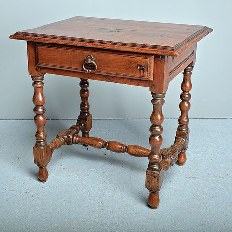 Antique carved two-drawer single-board top library table with mast legs, chestnut, walnut & oak