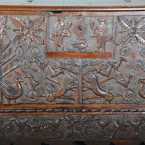 Antique heavily carved Basque arms chest, chestnut