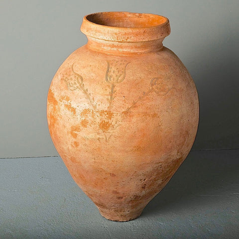 "Antique terracotta olive oil jar with engraved ""three tulip"" motif"