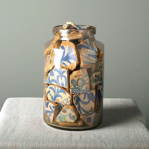 "Glass jar filled with antique Moorish ""Nazarid"" dynasty clay fragments"