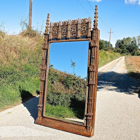 Antique monumental carved, painted and gilt Neo-Gothic mirror