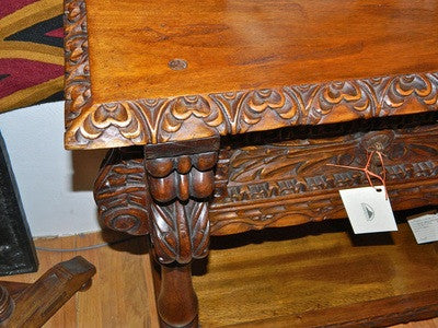 "Carved four-drawer reproduction ""Cusco"" console table, cachimbo hardwood"
