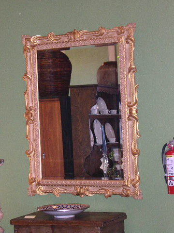 Carved mahogany mirror frame with original glass