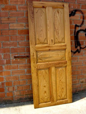 Single panel carved panel door in honey pine