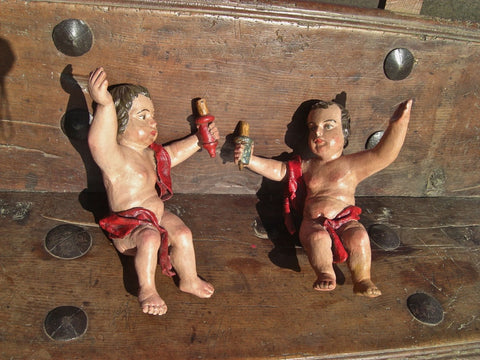 Antique carved and painted cherub torchere