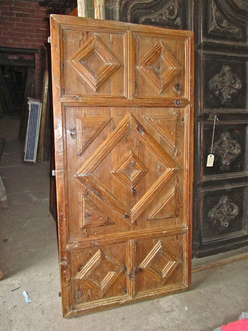 Antique carved and painted two-panel door with original frame, pine