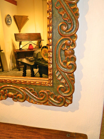Reproduction carved, polychromed and gilt Spanish colonial mirror frame, cachimbo hardwood