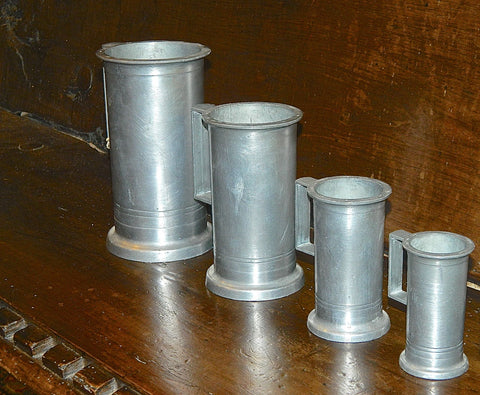 Antique set of seven pewter measures