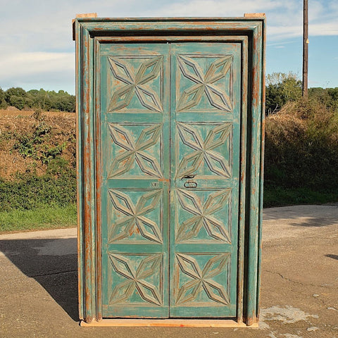 Antique carved single-panel door, honey pine
