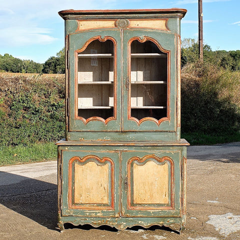 Small carved antique two-door cabinet, walnut