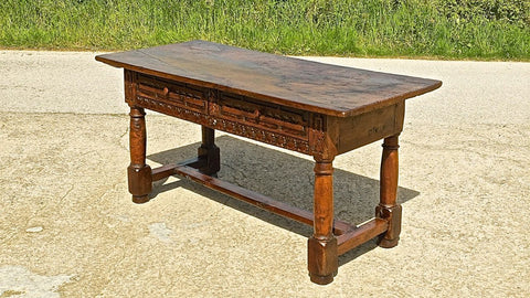 Antique carved two-drawer mast leg table with inlaid top, chestnut