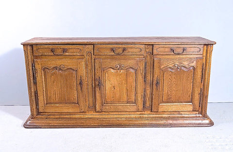 Antique three-door, three-drawer oak credenza