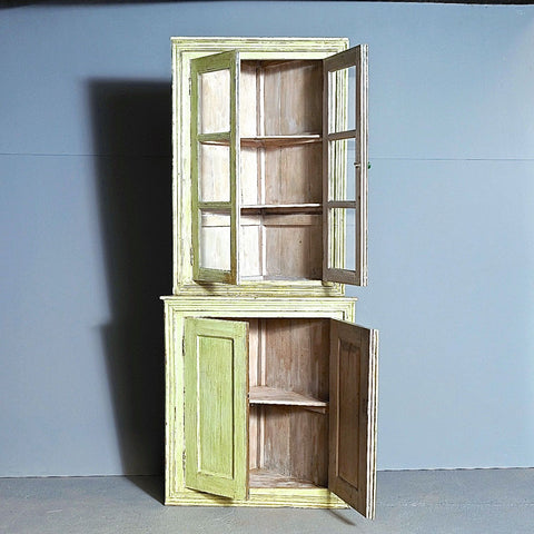 Antique painted four-door corner cabinet