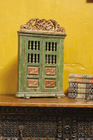 Reproduction carved, polychromed, and gilt mini corner cabinet.