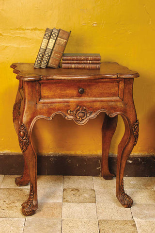 Carved two-drawer reproduction Spanish colonial nightstand with feathered legs, cachimbo hardwood