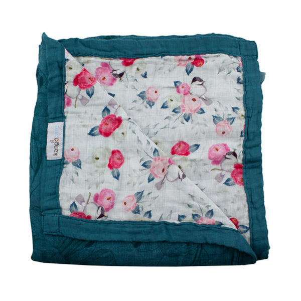 Side A :: Beautiful peony flowers in pinks and silver with delicate birds tucked away in the branches atop a faint lily flower design in the background. Side B :: A solid deep caribbean blue with the same lily backdrop in an enlarged shadow design. Kanga Care Serene Blanket - Lily