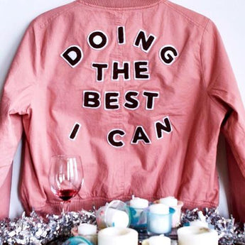 Custom Chainstitch Embroidered Letter on a Pink Bomber Jacket