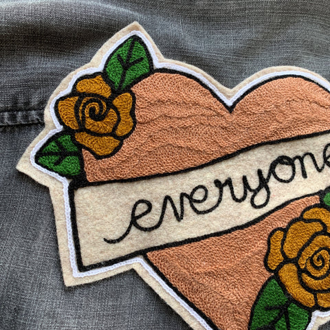 chainstitch embroidery heart with roses patch on denim jacket