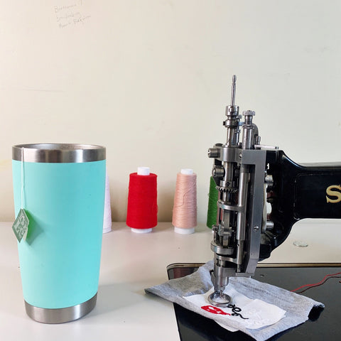 singer114w103 chainstitch embroidery machine and seafoam yeti mug