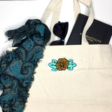 Custom chainstitch embroidery flower iron on patches you choose the colorCustom chainstitch embroidery flower iron on patches mint green and gold on a canvas tote bag