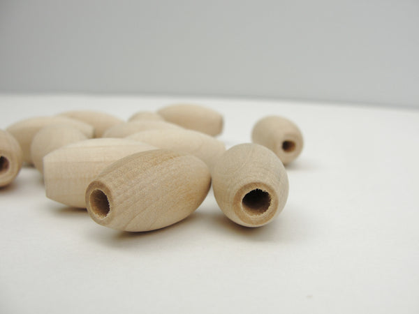 "Wooden oval beads 1"" x 9/16"" with a 3/16"" hole - Wood parts - Craft Supply House"