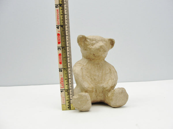 Small paper mache teddy bear