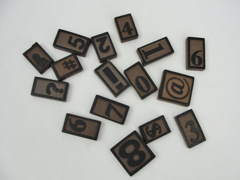 Wooden letterpress number and symbol tiles