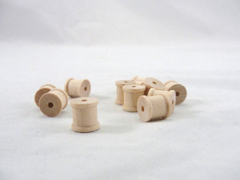 tiny wooden spool