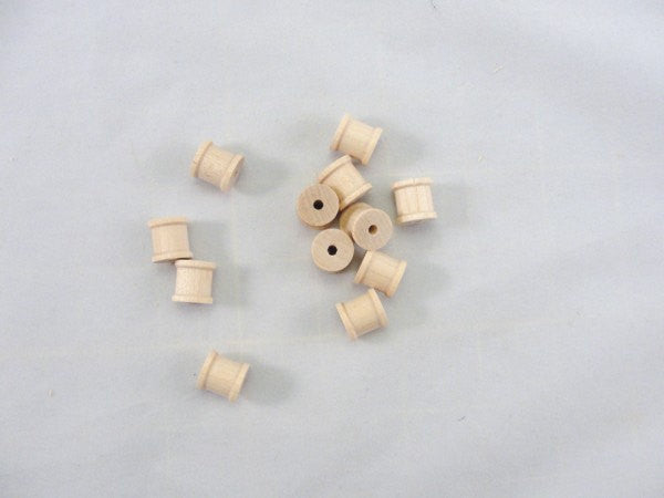 Little wooden spools 1/2 inch set of 12 - Wood parts - Craft Supply House