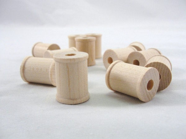 Little wooden spools 1 inch set of 12 - Wood parts - Craft Supply House
