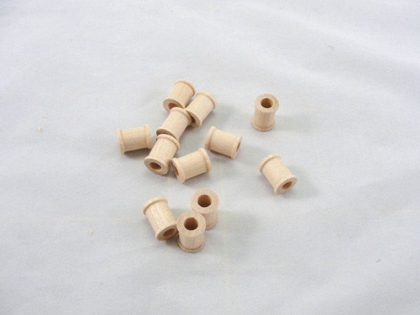 little wooden spools