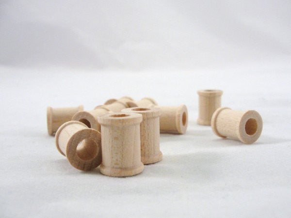 Little wooden spools 5/8 inch set of 12 - Wood parts - Craft Supply House