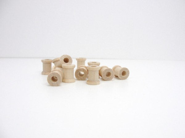 Miniature wooden spools 5/8 inch set of 12 - Wood parts - Craft Supply House