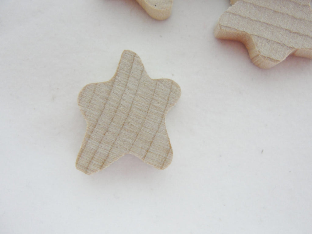 "Tiny Primitive wooden star 5/8"" wide and 3/4"" tall set of 12 - Wood parts - Craft Supply House"
