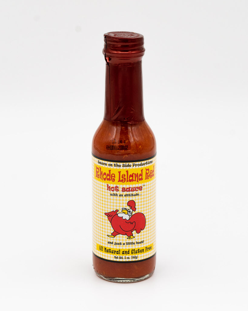 "A fabulous sauce that will enhance, not overpower, your food.  Made with peppers, tomatoes, carrots, vinegar, mustard, salt, sugar, and love.  Rhode Island Red has been described as addictive by hot sauce aficionados.  It's the perfect combination of peppers and other fresh vegetables that gives RI Red Hot it's distinctive ""sweet heat.""  5 oz. bottle - Case of 12"