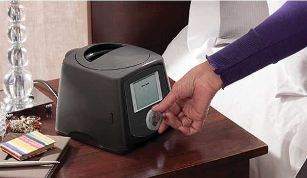 Human hand adjusting the CPAP machine device nob